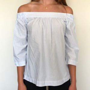 Off the shoulder baby blue and white striped top.